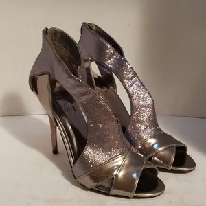 Guess silver shiny shoes size 9.5